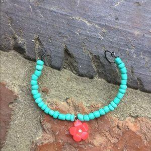A teal beaded bracelet with a flower bead!